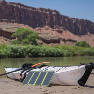 Nomad 28 Plus - Charging on Beach with Kayak