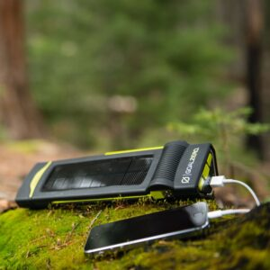 Torch 250 Flashlight - Charging iPhone on Moss